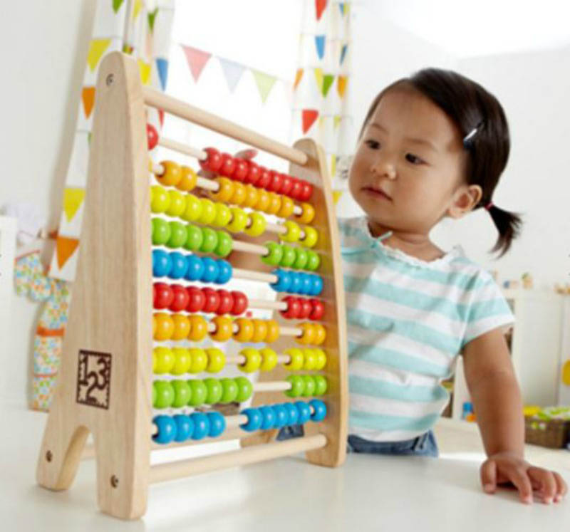 Little girl with abacus | Beanstalk Mums